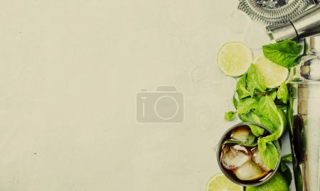 Photo for Alcoholic cocktail Cuba Libre, with rum, lime juice, cola and ice. Bar tools, top view, toned image - Royalty Free Image