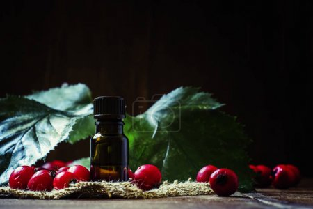 Essential oil of hawthorn in glass bottle