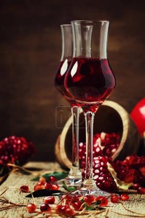 Pomegranate liqueur, still life in rustic style