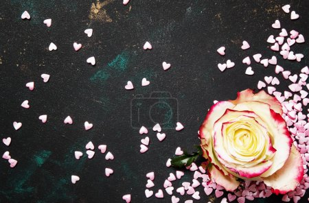 Photo for Festive background for Valentines Day, white rose and sweet pink hearts, top view - Royalty Free Image