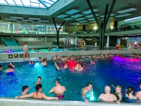 Michalovce, Slovakia - December 30, 2019: People resting at swimming pool in Thermal park Sirava