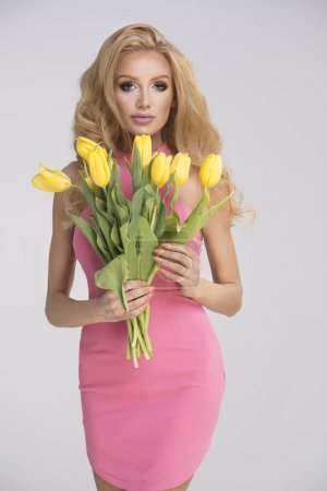 Blonde girl with yellow tulips