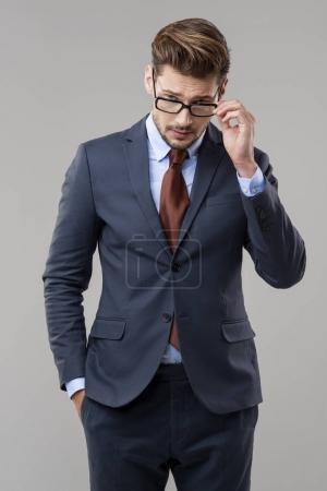 Elegant man in suit with glasses