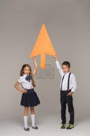 kids dressed in school uniform posing