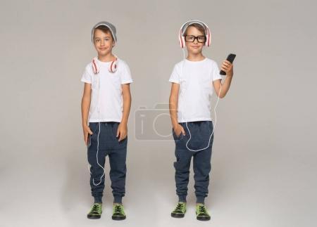 child with headphones, same boy