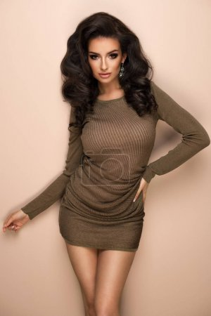 Photo for Sensual beautiful brunette woman over grey background - Royalty Free Image