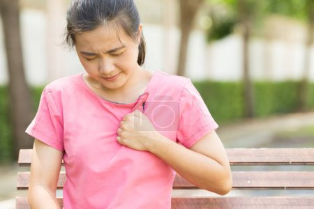 Woman has chest pain in the garden