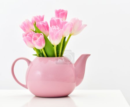 Photo for Bright spring bouquet in a porcelain teapot. Pink tulips. - Royalty Free Image