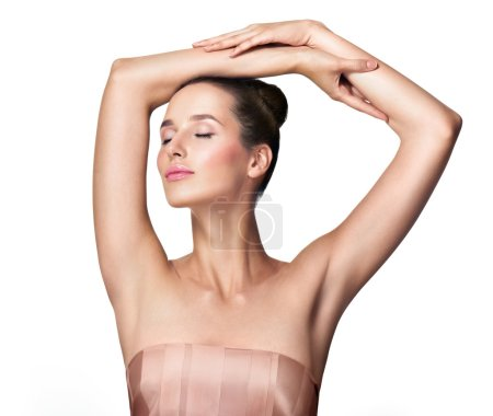 Photo for Beautiful young woman holding her arms up and showing clean underarms. Armpit's care. Armpit epilation, hair removal, perfect skin. - Royalty Free Image