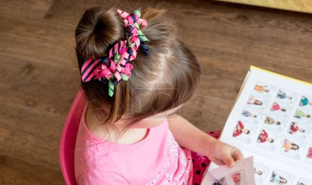 Photo for Little girl with book  on background, close up - Royalty Free Image