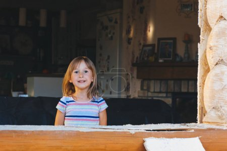 Photo for Little girl and wooden construction - Royalty Free Image
