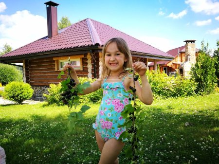 Photo for Beautiful young girl in garden - Royalty Free Image