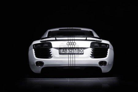Photo for Vinnitsa, Ukraine - November 11, 2012.Audi R8 concept car.Audi showroom.Presentation. Presentation of the new model Audi car - Audi R8.Front of the car,front-side, logo Audi.Black and white autophoto - Royalty Free Image