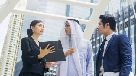 team global business people smart man and woman talk and discuss the project on the paper file at outdoor pedestrian walk way the city space modern building
