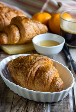 Photo for Continental breakfast with croissants, honey and coffee. Selective focus - Royalty Free Image