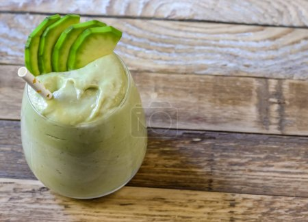Photo for Fresh blended Banana and avocado smoothie with yogurt or milk in glasses, healthy eating, superfood - Royalty Free Image