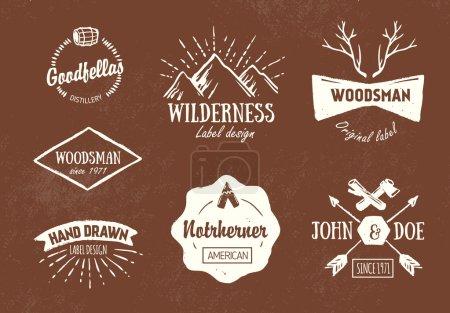 Ilustración de Conjunto de etiquetas de áspero vintage hechos a mano y elementos de diseño en marrón - Imagen libre de derechos
