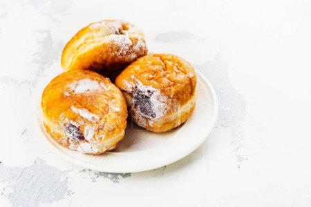 Tasty homemade donuts with jam