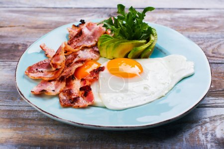 Photo for Continental breakfast with fried eggs, bacon and drinks. Ketogenic diet concept. Space for text - Royalty Free Image