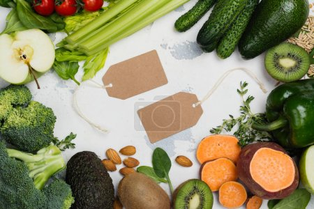 Photo for Green fruits and vegetables on white background. Healthy vitamin eating or alkaline diet concept. Copy space - Royalty Free Image