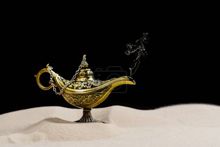 Photo for Aladdin magic lamp on the sand. Copy space - Royalty Free Image