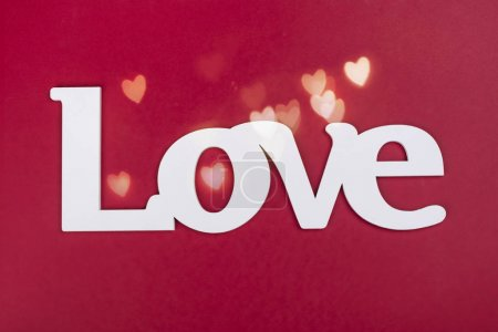 Photo for Wooden word LOVE on bright red background. Valentines day greeting card. Copy space - Royalty Free Image