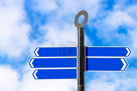 Photo for Empty directional sign against blue sky with clouds. Copy space. - Royalty Free Image