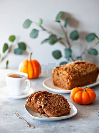 Photo for Delicious fresh bread  and tea on the table - Royalty Free Image