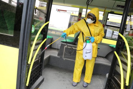 Photo for Lviv, Ukraine, 03 March 2020. Workers disinfect a trolleybus after it arrived at a bus depot.The first case of novel coronavirus Covid-19 has been confirmed in Ukraine. - Royalty Free Image
