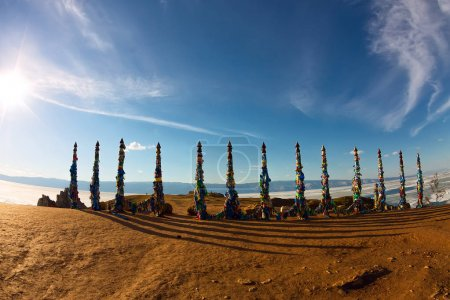 Shaman poles of serge on Olkhon in the sunset with long shadows