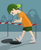 Computer addicted child walks down the street and attentively looks at his tablet Danger game and internet addiction