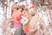 Outdoor happy couple in love posing in cold winter weather. Young boy and girl having fun outdoor