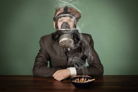 Teenage boy wearing a gas mask