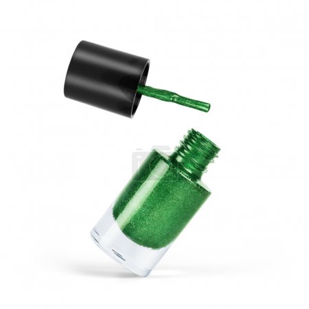 Green nail polish on a white background...