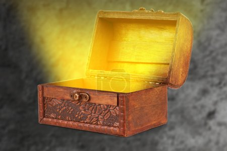 wooden treasure chest with a magical wispy light coming out of t