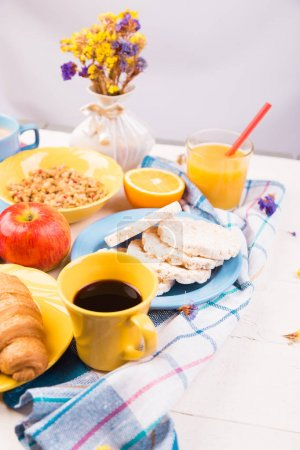 Photo for Healthy Breakfast. Various Assortment Set. Orange Juice, Granola, Croissant Coffee and Fruit - Royalty Free Image