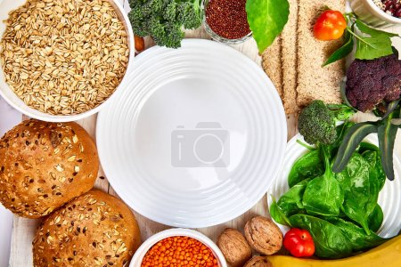 Photo for Selection food rich in fiber on white wooden background around empty plate, Healthy diet food product. Top view, flat lay, copy space - Royalty Free Image