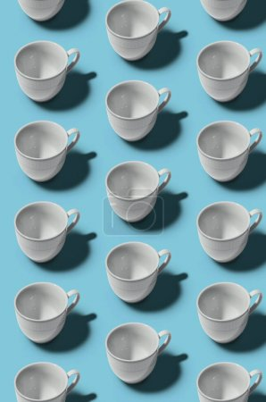 Photo for Cup concept. Pattern. Group of white cups on blue background. Creative style. - Royalty Free Image