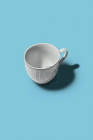 Photo for White cup on blue background.  Cup concept. Creative style. - Royalty Free Image