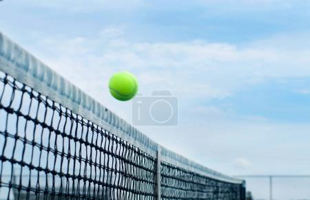 Tennis ball flying over middle