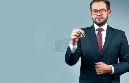 Photo for Businessman or real estate agent is holding keys. Finance Savings concept - Royalty Free Image
