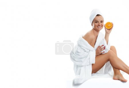 Beautiful woman in bathrobe. Beauty, cosmetics and spa concept