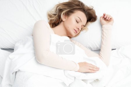 Photo for Beautiful woman sleeping in white bed - Royalty Free Image