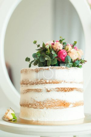 Decorated white naked cake rustic style for weddings, birthdays and events.