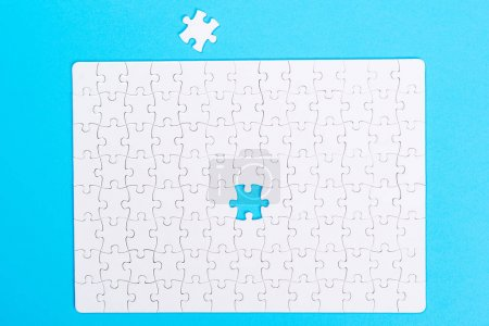 Photo for Missing jigsaw puzzle piece . Close up of the last jigsaw puzzle piece. Business concept for completing the final puzzle piece. - Royalty Free Image