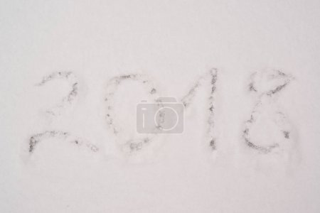 Year 2018 on snow background.