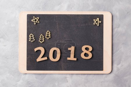 Signboard with 2018 on grey concrete background. New Year 2018 concept.