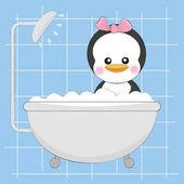 Cute little Penguin taking a bath