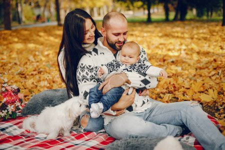 Photo for Family in a autumn park. Woman in a white sweater. Cute newborn little boy with parents - Royalty Free Image