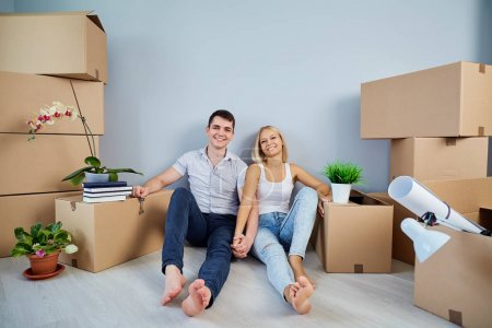 Photo for Young couple moving to a new apartment. Housewarming. - Royalty Free Image